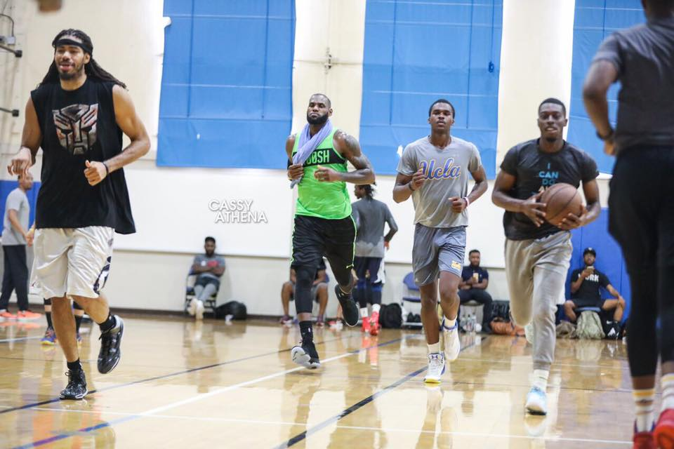 Fola running along Lebron James in Private NBA Run